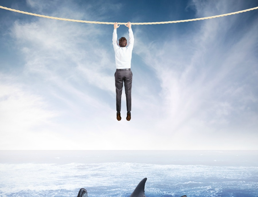 Crazy Man Dangling Above Sharks